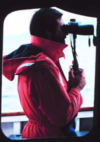 A marine mammal observer at work on the JOHN N. COBB